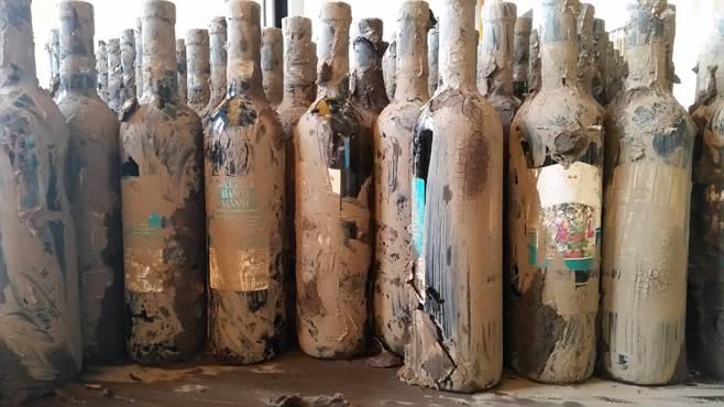 bottiglie-vino-fango-Solopaca